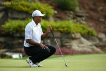 Tiger Woods struggles as Keegan Bradley in early control