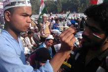 Called 'anarchists' and 'Naxals', AAP supporters celebrate as Arvind Kejriwal takes over as Delhi CM