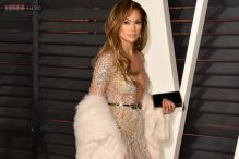 Look of the day: Jennifer Lopez makes a bold fashion choice in Zuhair Murad at Vanity Fair Oscar party
