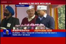 Dressed like common man, Arvind Kejriwal and team take oath