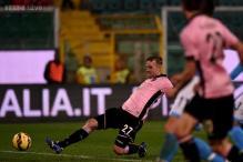 Napoli lose 3-1 at Palermo, fail to close gap on Roma
