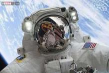 US astronauts begin spacewalk to lay cable at station