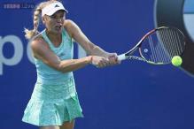 Top seed Caroline Wozniacki wins opener in Malaysia