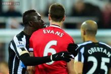 Papiss Cisse and Jonny Evans handed hefty bans for spitting