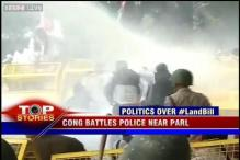 Congress workers protest against Land bill, clash with police
