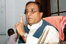 Azam Khan 'gifts' broom, pen to MLAs; taunts Modi