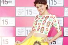 Look of the day:  Bright idea! Tapsee Pannu steals spotlight in Neha Agarwal creation at Lakme Fashion Week preview