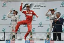Sebastian Vettel wins Malaysian Grand Prix to end Mercedes streak