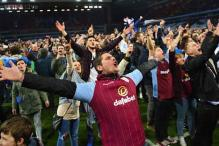 Aston Villa charged following fans' pitch invasion
