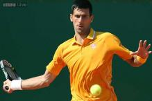 Novak Djokovic slides smoothly through in Monte Carlo