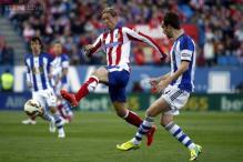 Atletico Madrid hard on Sociedad's heels, Sevilla down Levante