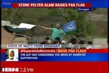 Kashmiri separatist leader Masarat Alam waves Pakistani flag to greet Syed Ali Geelani in Srinagar