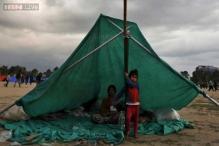 Desperate survivors sleep in the open as aftershocks spread fear in Nepal