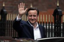 British Prime Minister David Cameron plans his new one-party Cabinet