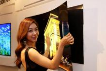 LG unveils super-slim 1mm thin 'wallpaper' TV that sticks to your wall using just magnets