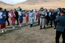 Modi wears Mongolian dress, tries his hands at archery at Mini-Naadam festival