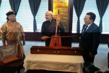 Snapshot: Narendra Modi tries his hands on morin khuur in Mongolia