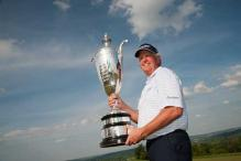 Golf: Colin Montgomerie retains Senior PGA title by four shots
