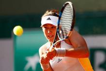 Garbine Muguruza charges into French Open third round