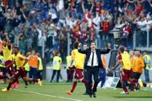 Dramatic derby win sends Roma into Champions League