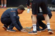 Players slam courtside holes at Italian Open
