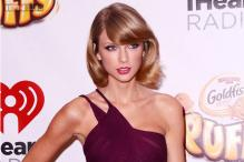 Apple agrees to pay artists for all music streaming after Taylor Swift threatens to pull out hit music album '1989'