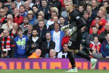 Manchester United midfielder Juan Mata backs goalkeeper Victor Valdes