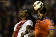 Valencia's Champions League bid hit by Rayo draw