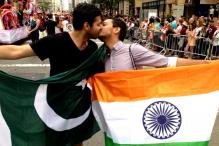 Photo of the day: This picture of a gay couple kissing in Pride is the perfect example of 'make love, not war'