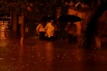 Mumbai local train services hit by heavy rains, thousands of commuters stranded