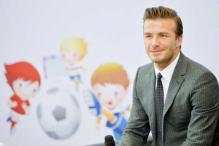 Daughter Harper gets Beckham inked with a Minion tatoo