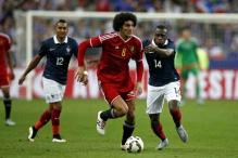 Marouane Fellaini nets double as Belgium humble France