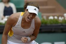 Efficient Muguruza repeats run to French Open quarters