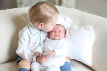 Photo of the day: Prince George protectively kisses his sister Princess Charlotte in the first official picture of the two