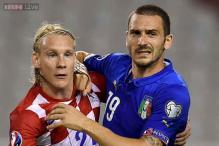 Italy hold Croatia in thriller at empty stadium