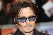 Johnny Depp ready to 'assault' an Australian politician for wife Amber Heard