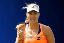 Angelique Kerber claims first grasscourt title
