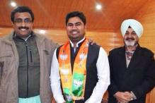 Illegal lottery kingpin Martin's son Charles joins BJP, seen with Ram Madhav