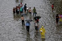 Two days on, heavy rains paralyse Mumbai, two die of electrocution; local trains cancelled