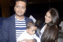 Snapshot: Doting daddy Riteish Deshmukh carries son Riaan through airport as mother Genelia looks on