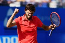 Gilles Simon beats Milos Raonic to reach Queen's Club semis