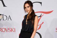Victoria Beckham ditches high heels for flats