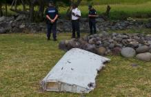 Malaysia says debris found in Indian Ocean 'looks certain' of MH370