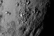 First close-up look at Pluto shows huge ice mountains and chasms