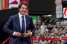Suited and booted Tom Cruise wows spectators at 'Mission: Impossible 5' premiere