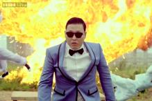 'Gangnam Style' star Psy's car collides with a bus