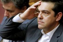 Greek lawmakers pass contentious austerity bill despite dissent