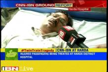 The injured passengers from the train derailment incident are brought to Harda district hospital