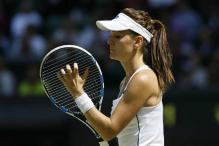 No. 7 Radwanska rallies to reach quarters at Stanford
