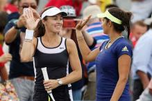 Sania in Cincinnati semis; Bopanna, Paes bow out